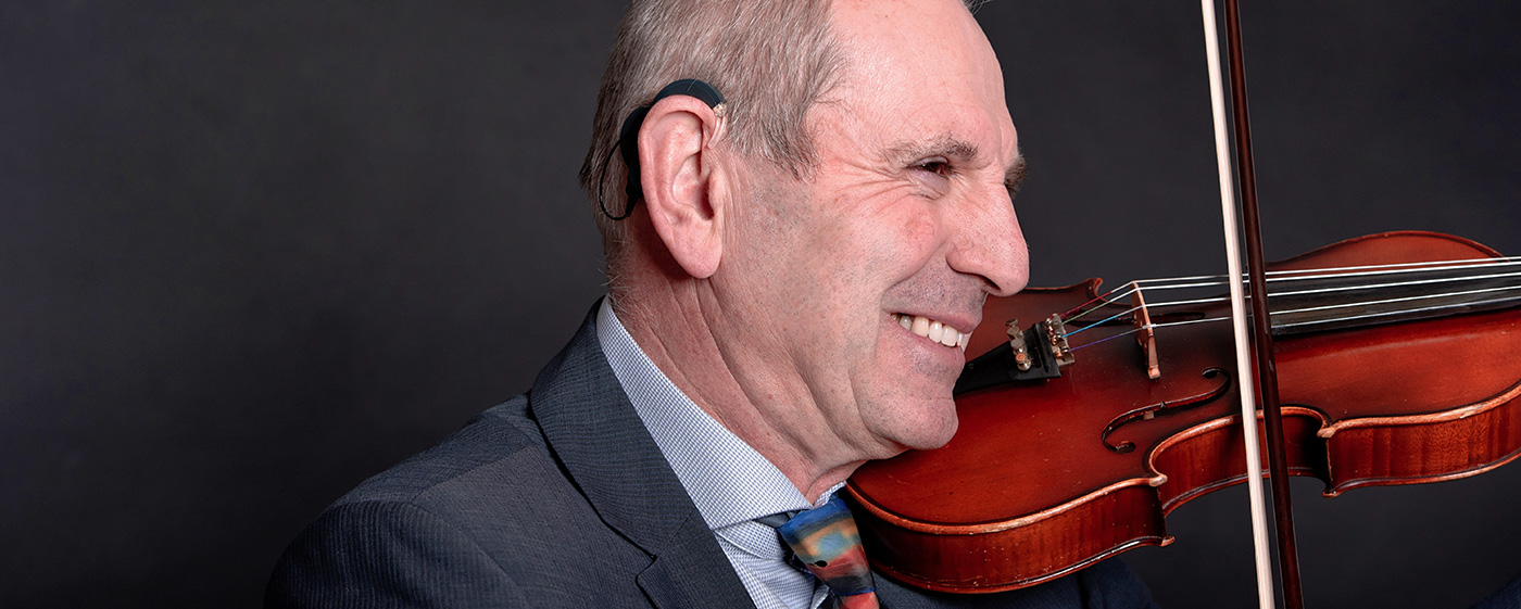 cochlear implant and music: the musician and CI user Walter with his violin