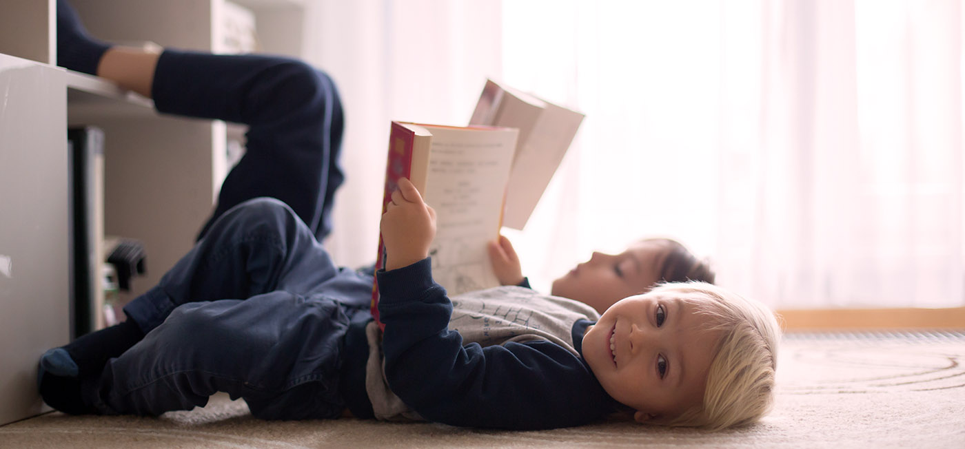 Education and hearing - two little boys reading